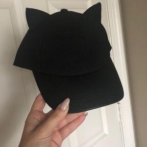 Cat ears hat. Brim is faux leather.